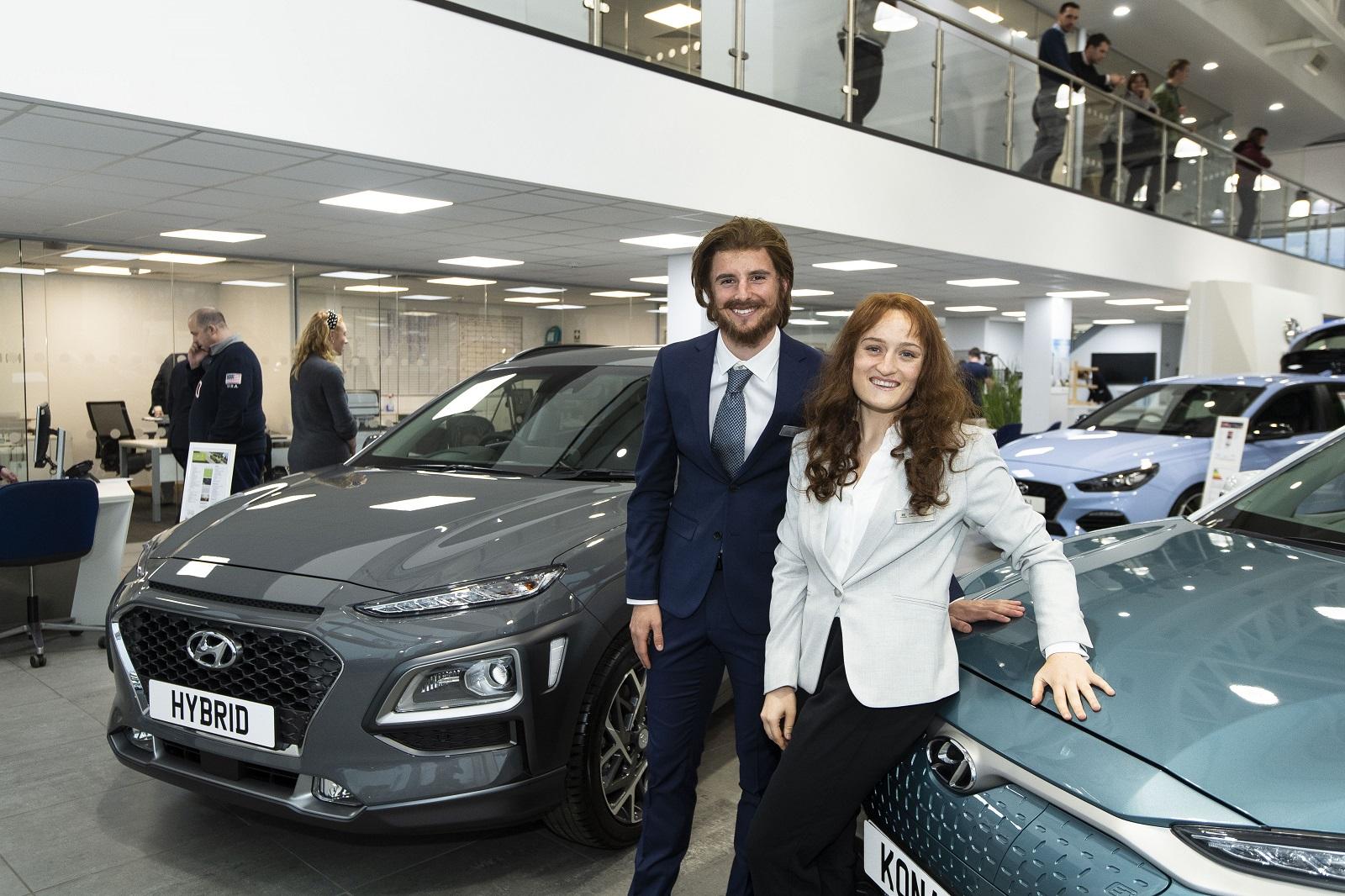 Erin and Mason disguised as Hyundai car dealers